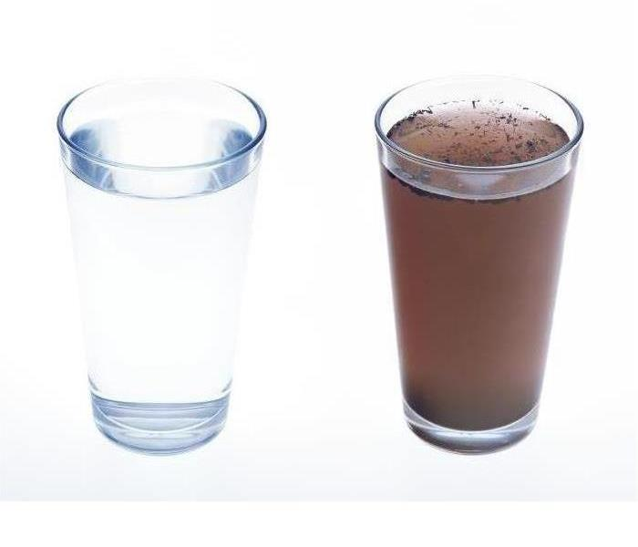 Two glasses of water are shown one is clear and one has a brown color in the water